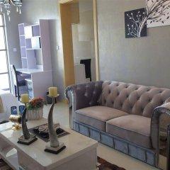 Апартаменты Private Enjoyed Home Aoyuan Apartment комната для гостей фото 3