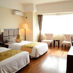 Отель Sweetome Vacation Rentals Wanda Plaza Китай, Сямынь - отзывы, цены и фото номеров - забронировать отель Sweetome Vacation Rentals Wanda Plaza онлайн комната для гостей фото 3