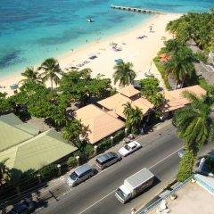 Отель Ocean Suite Beach Front at Mobay Club пляж