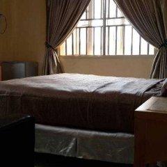 Mikagn Hotel and Suites Ибадан удобства в номере фото 2