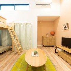 Отель Trip Pod Takasago B Фукуока комната для гостей