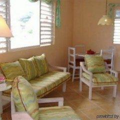 Отель Sunflower Cottages and Villas Ямайка, Ранавей-Бей - отзывы, цены и фото номеров - забронировать отель Sunflower Cottages and Villas онлайн комната для гостей