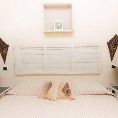 Hotel Cernia Isola Botanica Марчиана сейф в номере