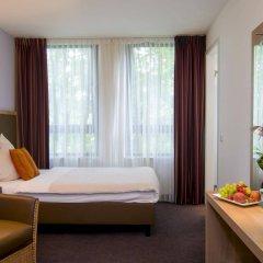 Отель ACHAT Premium Hotel München Süd Германия, Мюнхен - 1 отзыв об отеле, цены и фото номеров - забронировать отель ACHAT Premium Hotel München Süd онлайн комната для гостей фото 5