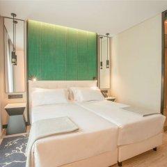 Отель NH Hotel Porto Jardim Португалия, Порту - отзывы, цены и фото номеров - забронировать отель NH Hotel Porto Jardim онлайн комната для гостей фото 3