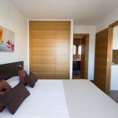 Апартаменты Pio XII Apartments комната для гостей фото 3