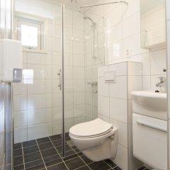 Отель Birkebeineren Hotel & Apartments Норвегия, Лиллехаммер - отзывы, цены и фото номеров - забронировать отель Birkebeineren Hotel & Apartments онлайн ванная