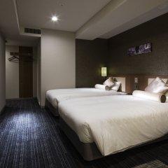 Отель UNIZO Tokyo Ginza-itchome Япония, Токио - отзывы, цены и фото номеров - забронировать отель UNIZO Tokyo Ginza-itchome онлайн комната для гостей