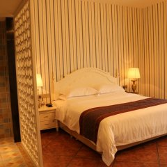 Отель Shi Ji Huan Dao Hotel Китай, Сямынь - отзывы, цены и фото номеров - забронировать отель Shi Ji Huan Dao Hotel онлайн комната для гостей фото 2