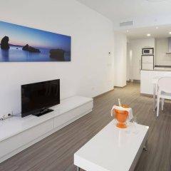 Апартаменты AxelBeach Ibiza Suites Apartments Spa and Beach Club - Adults Only комната для гостей фото 3