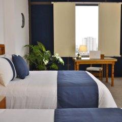 Hotel Misión Guadalajara Carlton комната для гостей фото 3