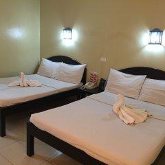 Отель Sampaguita Suites Plaza Garcia Филиппины, Лапу-Лапу - 2 отзыва об отеле, цены и фото номеров - забронировать отель Sampaguita Suites Plaza Garcia онлайн комната для гостей фото 4