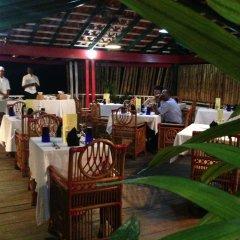 Отель Mangos Boutique Beach Resort