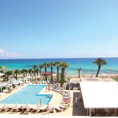 Отель Vrissiana Beach Hotel Кипр, Протарас - 1 отзыв об отеле, цены и фото номеров - забронировать отель Vrissiana Beach Hotel онлайн пляж фото 4