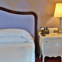 Отель UNAHOTELS Expo Fiera Milano Италия, Милан - отзывы, цены и фото номеров - забронировать отель UNAHOTELS Expo Fiera Milano онлайн удобства в номере фото 2