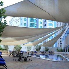 Отель Swiss-Belhotel Sharjah бассейн фото 2