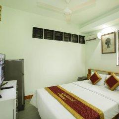 Отель Huyen Tra Que Homestay сейф в номере