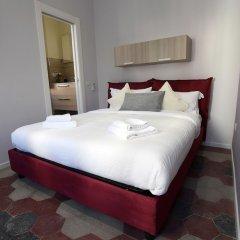 Отель APPARTAMENTO SANTI QUATTRO 1 e 2 - COLOSSEO комната для гостей фото 5