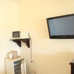 Отель Altamont West Hotel Ямайка, Монтего-Бей - отзывы, цены и фото номеров - забронировать отель Altamont West Hotel онлайн удобства в номере