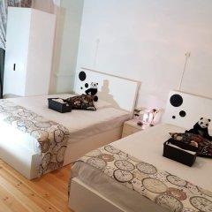 Отель At Ease Inn - Residence комната для гостей