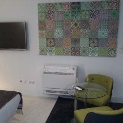 Отель Alma Moura Residences удобства в номере
