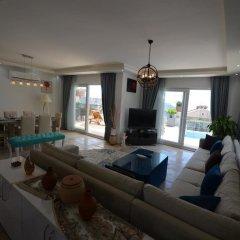 Villa Esma by Akdenizvillam Турция, Калкан - отзывы, цены и фото номеров - забронировать отель Villa Esma by Akdenizvillam онлайн комната для гостей фото 5