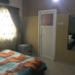 Отель Richmond Hills Suites Энугу комната для гостей