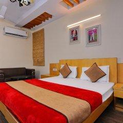Отель OYO 5943 TJS Grand комната для гостей фото 2