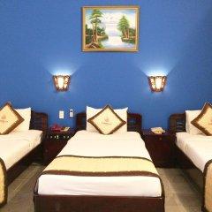 Lotus Hoi An Boutique Hotel & Spa Хойан комната для гостей