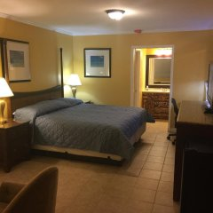 Отель Dragon Inn & Suites комната для гостей фото 3