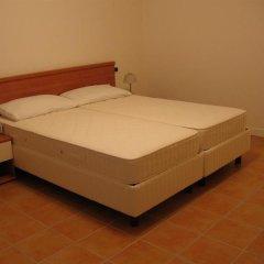 Отель Residence Porto Letizia Порлецца комната для гостей
