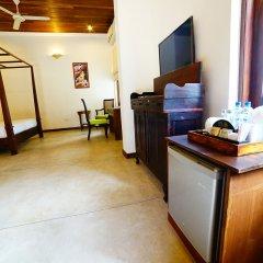 Отель Lespri Grand удобства в номере