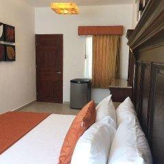 Отель Las Golondrinas Плая-дель-Кармен удобства в номере фото 2
