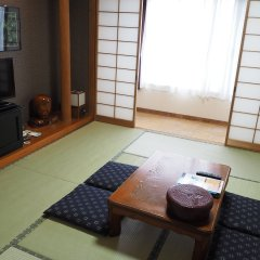 Отель Seaside Hotel Yakushima Япония, Якусима - отзывы, цены и фото номеров - забронировать отель Seaside Hotel Yakushima онлайн комната для гостей фото 2