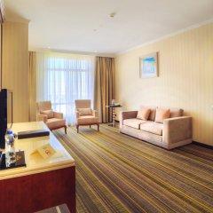 Отель Шера Парк Инн Алматы комната для гостей