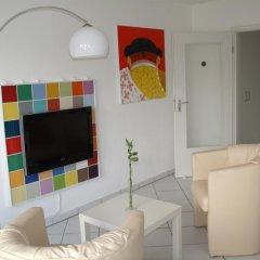 Апартаменты Business meets Düsseldorf Apartments Дюссельдорф комната для гостей фото 2