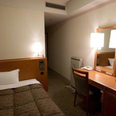 Toshi Center Hotel сейф в номере
