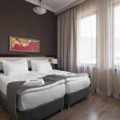 Апартаменты Gorky Gorod Apartments Красная Поляна комната для гостей фото 4