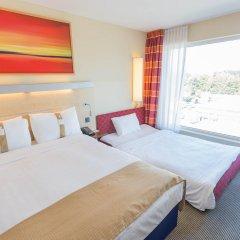 Отель Holiday Inn Express Zurich Airport Швейцария, Рюмланг - 1 отзыв об отеле, цены и фото номеров - забронировать отель Holiday Inn Express Zurich Airport онлайн комната для гостей фото 5