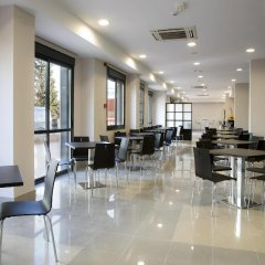 Отель Compostela Suites питание