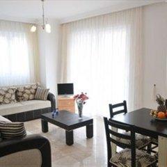 Апартаменты Hisar Garden Apartments Олудениз комната для гостей фото 2