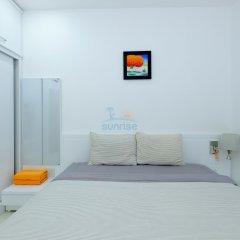 Апартаменты Sunrise Ocean View Apartment Нячанг сейф в номере