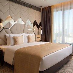Гостиница Double Tree By Hilton Minsk комната для гостей фото 4