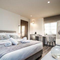 Отель Urban Nest - Suites & Apartments Греция, Афины - отзывы, цены и фото номеров - забронировать отель Urban Nest - Suites & Apartments онлайн комната для гостей