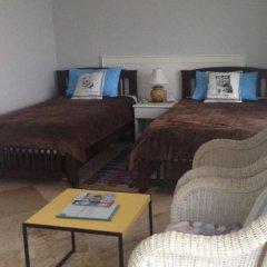 Отель Yiasu Serviced Apartments Таиланд, Паттайя - отзывы, цены и фото номеров - забронировать отель Yiasu Serviced Apartments онлайн комната для гостей фото 3