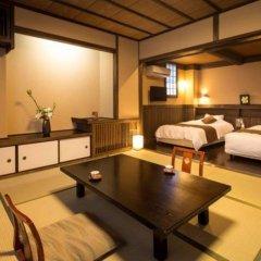 Отель Kurokawa Onsen Ryokan Wakaba Минамиогуни комната для гостей