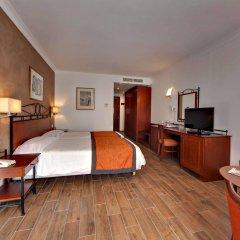 Отель Golden Tulip Vivaldi Hotel Мальта, Сан Джулианс - 2 отзыва об отеле, цены и фото номеров - забронировать отель Golden Tulip Vivaldi Hotel онлайн комната для гостей фото 3