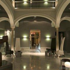 Отель Petit Palace Santa Cruz Испания, Севилья - отзывы, цены и фото номеров - забронировать отель Petit Palace Santa Cruz онлайн интерьер отеля фото 2