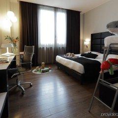 Отель Holiday Inn Genoa City Италия, Генуя - 1 отзыв об отеле, цены и фото номеров - забронировать отель Holiday Inn Genoa City онлайн комната для гостей фото 2