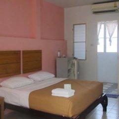 Апартаменты Baan Klang Noen Apartment Паттайя комната для гостей фото 2